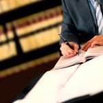 Image of a lawyer assisting in documentation for the Texas Second Chance Act & RDAP